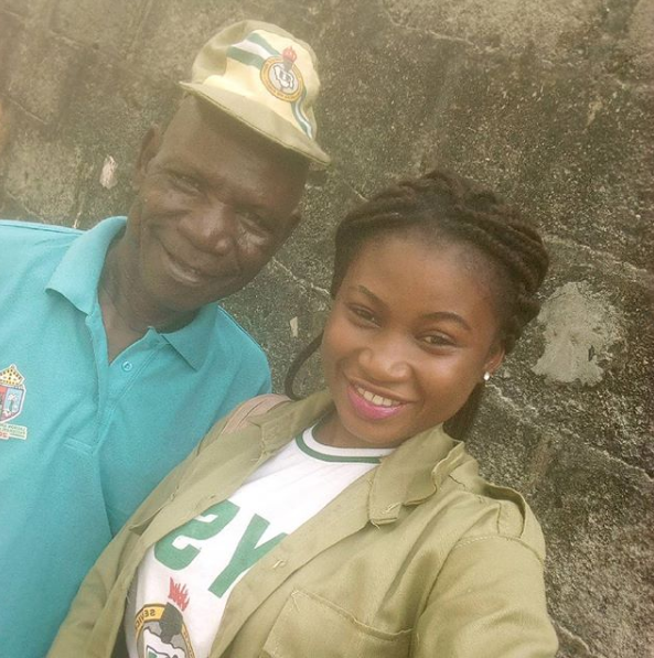 Young female corper proudly shows off her dad