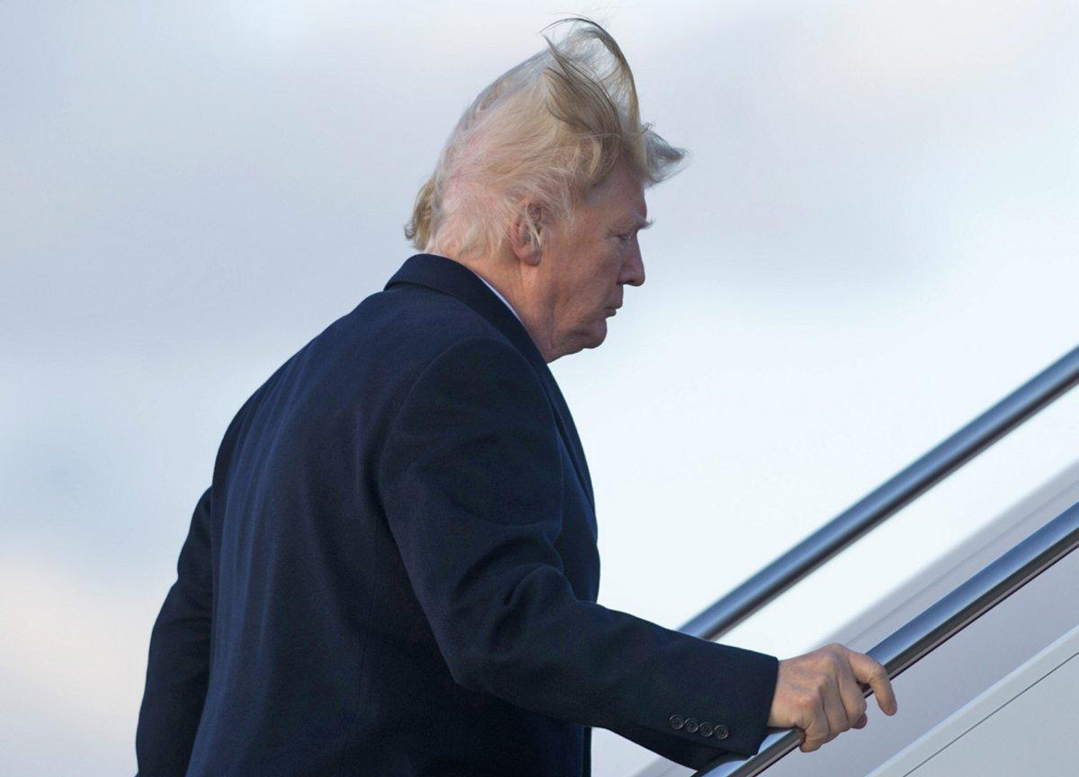 Donald Trump has a hair malfunction as wind exposes his bare scalp