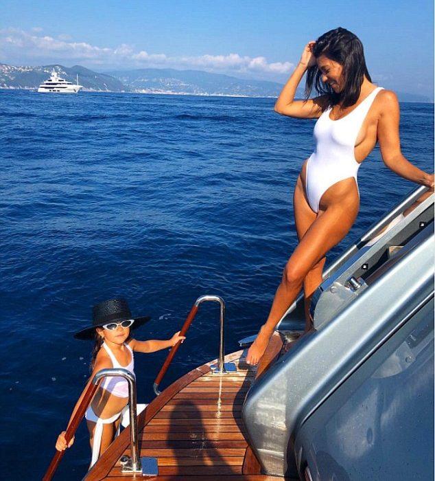 Kourtney Kardashian and daughter Penelope Disick rock matching while swimwear