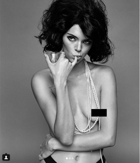 Kendall Jenner poses topless in black and white image