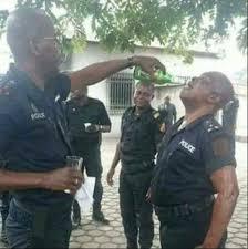 Police arrest Inspector found with beer bottle