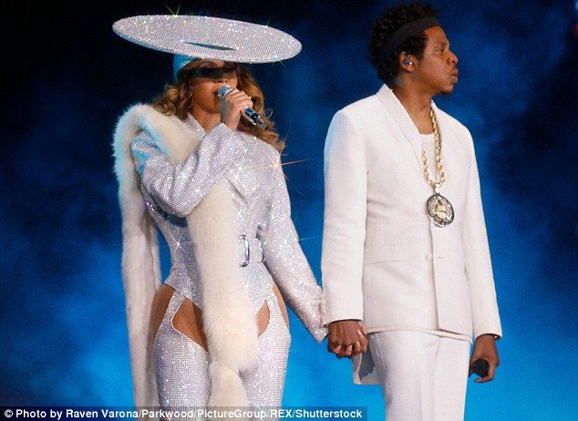 Beyonce flaunts her famous derriere on stage with Jay-Z