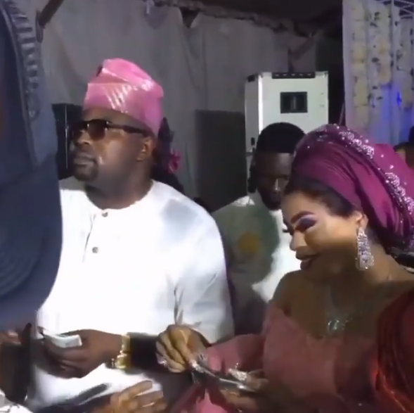 Going to jail? Bobrisky makes it rain at wedding