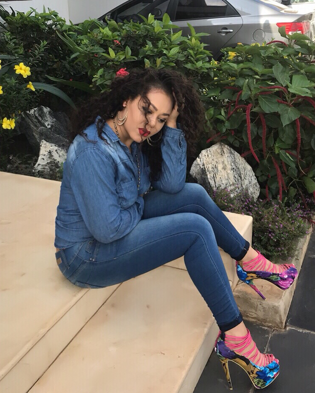 The denim clad beauty looked gorgeous as she striked variius poses in  dangerously high heeled shoes.
