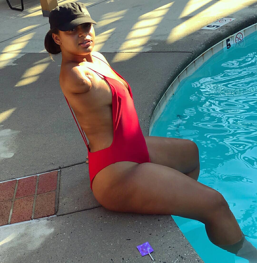 The Confident Lady Showed Off Her Curves In A Red Swimsuit