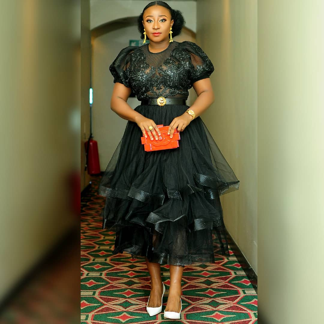 Image result for Ini Edo wearing a black gown